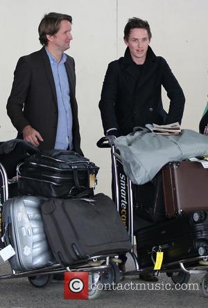 Tom Hooper and Eddie Redmayne