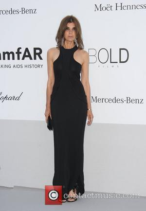 Carine Roitfeld and Kenneth Cole AmfAR's Cinema Against Aids gala 2012 during the 65th annual Cannes Film Festival Cannes, France...
