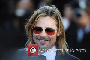 Brad Pitt And Paisley Win Big Daddy Honours