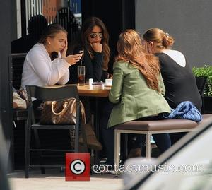 Chloe Green enjoys an afternoon drinking and smoking with friends in Notting Hill. London, England - 18.06.12