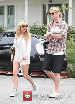 Elsa Pataky, husband Chris Hemsworth and their daughter India Rose in Santa Monica after having lunch at Kaffe K on...