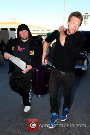 Chris Martin Coldplay frontman Chris Martin in good spirits as he arrives at LAX airport. Martin stopped and signed an...