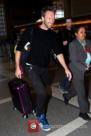 Chris Martin Coldplay frontman in good spirits as he arrives at LAX airport  Featuring: Chris Martin Where: Los Angeles,...
