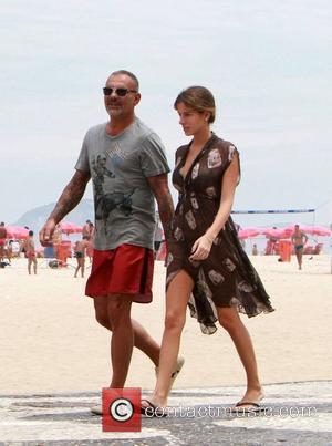 French fashion designer Christian Audigier and his girlfriend Nathalie Sorensen take a walk along Copacabana beach Rio De Janeiro, Brazil...