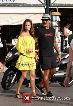 French Designer Christian Audigier and his girlfriend Brazilian model Nathalie Sorensen taking a walk during a romantic holiday weekend Saint-Tropez,...
