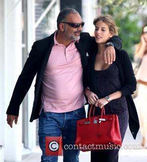 Christian Audigier and his girlfriend Nathalie Sorensen  attend Art Basel Miami Beach  Miami, Florida - 04.12.11