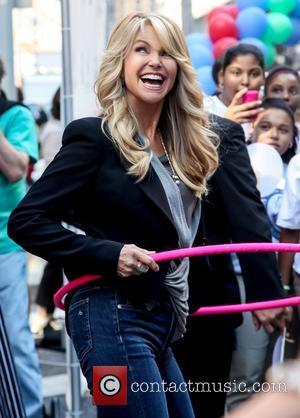Christie Brinkley along with Famiglia Pizza hosts 'World Smile Day' in Times Square New York City, USA - 05.10.12