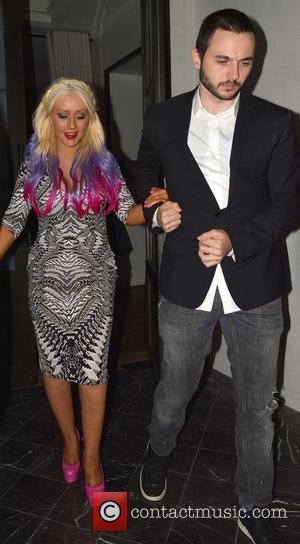 Christina Aguilera and boyfriend Matthew Rutler leave Spago restaurant in Beverly Hills Los Angeles, California - 28.09.12