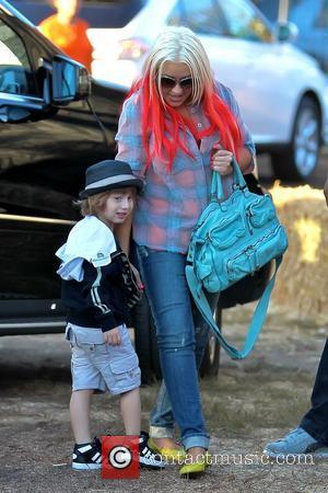 Christina Aguilera and Max Bratman Christina Aguilera enjoys a day at Mr. Bones Pumpkin Patch with her son and boyfriend...