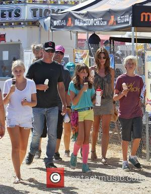 Cindy Crawford eating an ice cream with husband Rande Gerber and daughter Kaia Jordan Gerber at the 31st Annual Malibu...