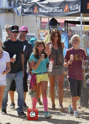 Cindy Crawford eating an ice cream with husband Rande Gerber daughter Kaia Jordan Gerber at the 31st Annual Malibu Kiwanis...