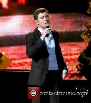 Scotty McCreery performing at the 2012CMA Country Christmas at Bridgestone Arena in Nashville Tennessee, USA - 03.11.12