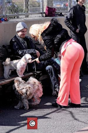 Coco Austin walking her dog Spartacus in Manhattan New York City, USA - 27.03.12