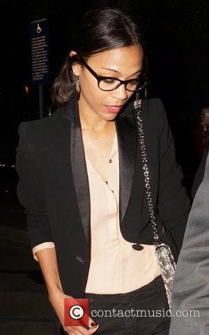 Zoe Saldana Celebrities arrive at The Hollywood Bowl to watch Coldplay in concert Los Angeles, California - 04.05.12