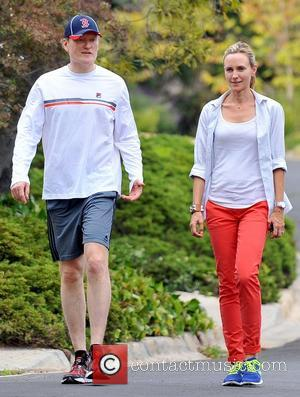 Conan O'Brien and Liza O'Brien Conan O'Brien, sporting a Boston Red Sox hat, walks with his wife in Brentwood Los...