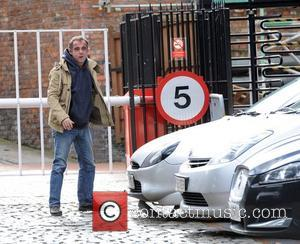 Michael Le Vell, who plays Kevin Webster in 'Coronation Street', checks for damage under his Ford Puma car. The actor...