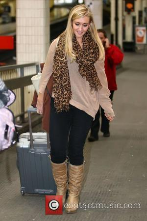 Catherine Tyldesley Coronation Street stars arrives a London's Euston train station ahead of the National Television Awards on Wednesday (25Jan12)...