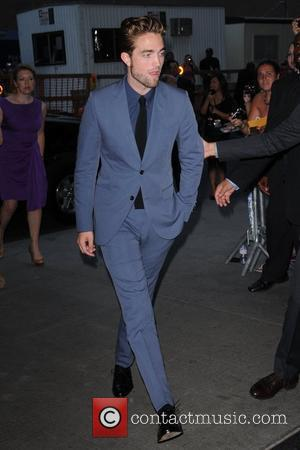 Robert Pattinson All Smiles At Cosmopolis Premiere (Photos)