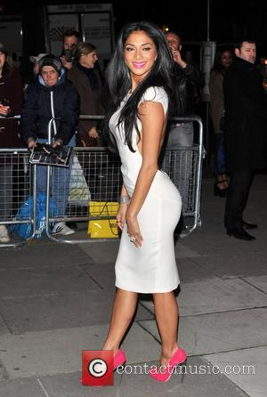 Nicole Scherzinger Turns Shop Girl In Supermarket