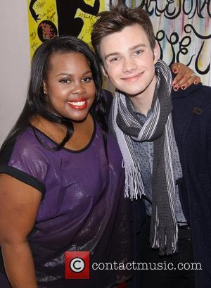 Amber Riley and Chris Colfer from the TV show 'Glee' greet each other backstage after Riley's performance in 'Cotton Club...