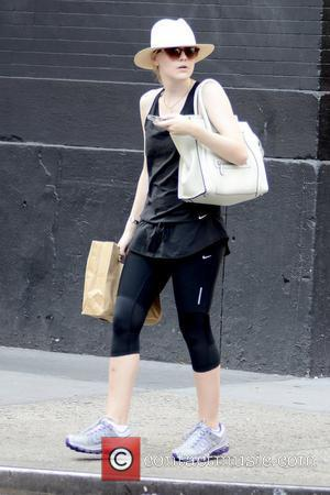 Dakota Fanning Laughs Off Perfume Furore