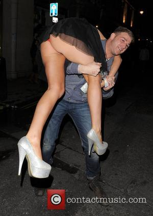 Danielle Mason and boyfriend Tony Giles out and about in Soho. Tony risked the wrath of Danielle by picking her...