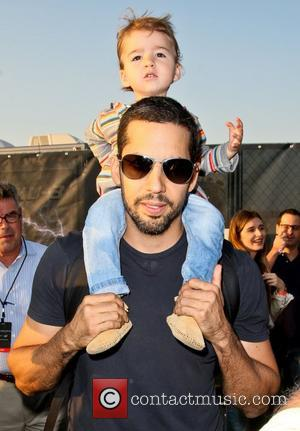 David Blaine and daughter Dessa   walk around the site of his latest challenge, 'Electrified' which features Blaine attached...