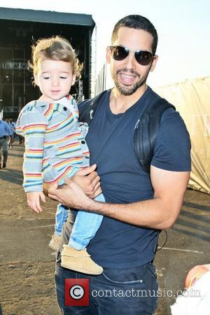 David Blaine and daughter Dessa  walk around the site of his latest challenge, 'Electrified' which features Blaine attached to...