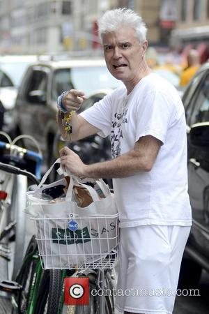 David Byrne Former Talking Heads frontman returns to his bicycle with groceries, after shopping at Whole Foods Market  New...