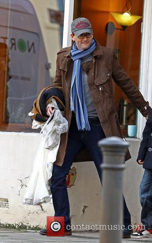 Newlywed actor David Tennant carries what appears to be a wedding dress to a dry cleaner  London, England -...