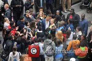 Terrence Howard is mobbed by fans  on the set of 'Dead Man Down' on Walnut Street. The film tells...