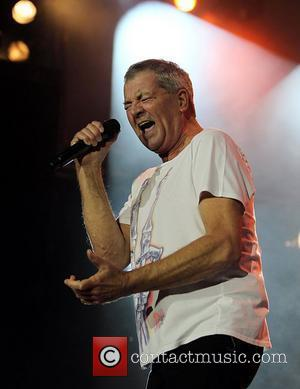 Deep Purple's Ian Gillan performing on stage at the O2 Arena as part of Deep Purple with a 32 piece...