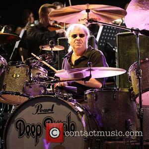 Deep Purple's Ian Paice performing on stage at the O2 Arena as part of Deep Purple with a 32 piece...
