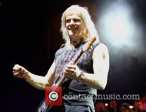 Deep Purple's Steve Morse performing on stage at the O2 Arena as part of Deep Purple with a 32 piece...