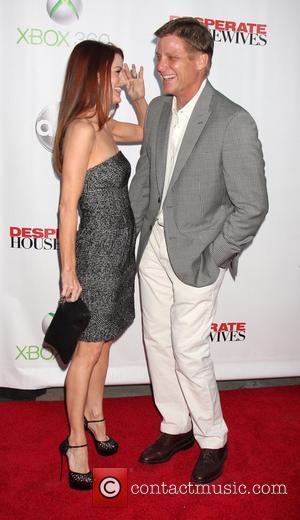 Laura Leighton and Doug Savant