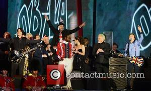 Paul McCartney performs with Will.i.am, Cheryl Cole, Tom Jones and others at The Diamond Jubilee Concert at Buckingham Palace. London,...