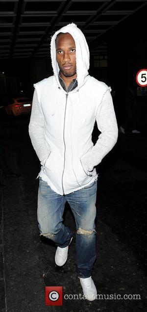 Didier Drogba arrives at Novikov Restaurant in Mayfair in a white hoodie London, England - 18.04.