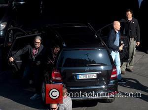 Bruce Willis gets out of a car on the film set of 'A Good Day to Die Hard' Hungary, Budapest...