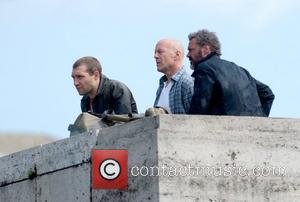 Jai Courtney, Bruce Willis and Sebastian Koch shooting a scene on the film set of 'A Good Day to Die...
