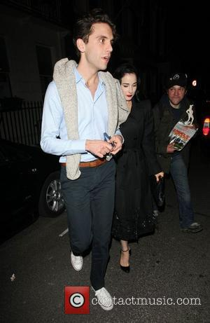 Mika and Dita Von Teese leave the Arts Club together in a red vintage car London, England - 18.06.12