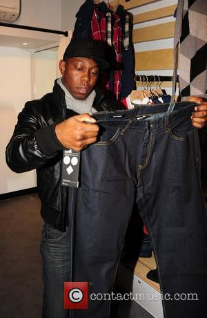 Dizzee Rascal shopping at the opening of 'Boxpark', a pop-up shopping complex created from shipping containers in London's trendy Shoreditch...