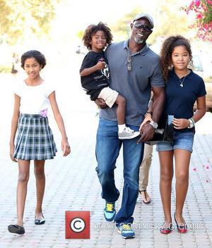 Kenzo Lee Hounsou, Djimon Hounsou, Ming Lee Simmons and Aoki Lee Simmons Djimon Hounsou at the Malibu Country Mart with...
