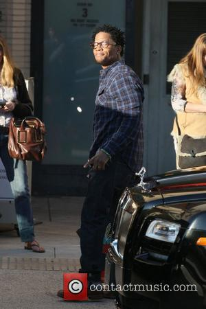 DL Hughley is seen shopping for gifts on Christmas Eve at Barney's New York in Beverly Hills Los Angeles, California...