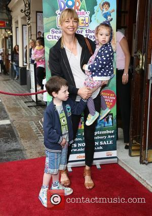 Sara Cox with her children Lola and Isaac Celebrity & Press Performance of Nickelodeon's Dora the Explorer at the Apollo...