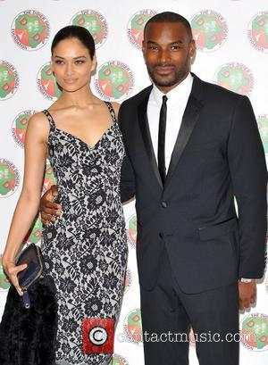Tyson Beckford and guest The Didier Drogba Foundation Charity Ball held at The Dorchester. London, England - 10.03.12