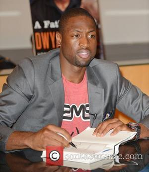 Dwyane Wade  greets fans and signs copies of his new book 'A Father First: How My Life Became Bigger...