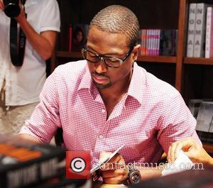 Dwyane Wade  greets fans and signs copies of his book 'A Father First: How My Life Became Bigger Than...