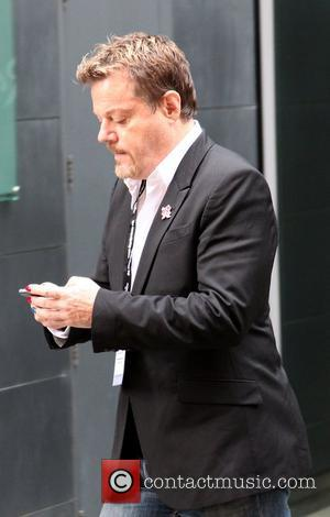 Eddie Izzard seen texting on his mobile phone as he heads to the Labour Party conference Manchester, England - 01.10.12