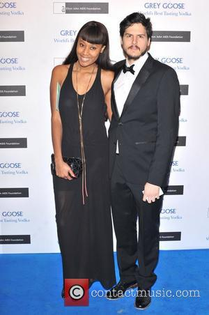 V V Brown and guest The Elton John AIDS Foundation Grey Goose Winter Ball held at the Battersea Power Station....