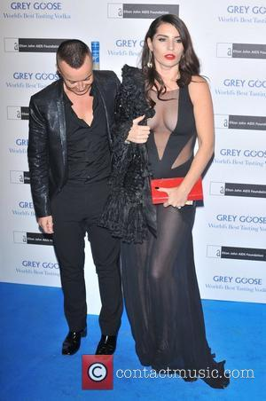 Julien MacDonald and Grace Woodward The Elton John AIDS Foundation Grey Goose Winter Ball held at the Battersea Power Station....